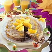 Pancake cake with chocolate and orange segments