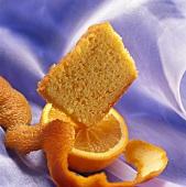 Piece of orange cake on half an orange
