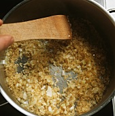 Sweating onions and rice until translucent