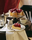 Raspberry souffle gateau with icing sugar; coffee