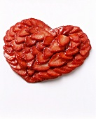 Heart made from sliced strawberries