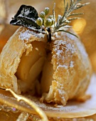 Vanilla apples in puff pastry with icing sugar (cut into)