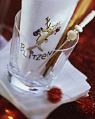 Napkin with the word Blitzen in empty glass