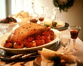 Roast goose with stuffed baked apples