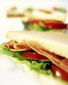 Tramezzini with ham, tomatoes and cucumber