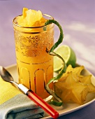 Orange and lime drink with carambolas