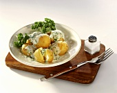 New potatoes in parsley sauce