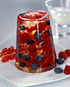 Champagne jelly with berries on plate