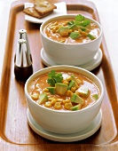 Sweetcorn and avocado soup in bowls on tray
