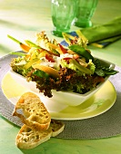 Green salad with vegetables & baby corncobs; white bread