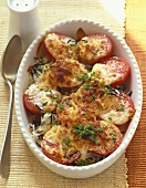Baked tomatoes on rice in baking dish