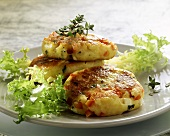 Potato cakes with feta and tomatoes, with salad garnish