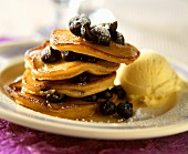 Blueberry pancakes with honey, icing sugar & vanilla ice cream