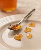 Grape jelly on spoon and plate