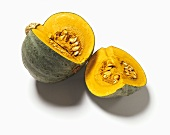 Green pumpkin (variety: Kabocha), cut into