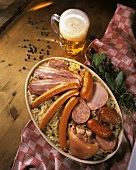 Alsatian meat platter with sauerkraut and beer