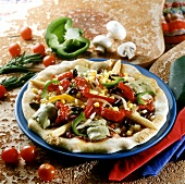 Mexican pizza with artichokes, peppers and sweetcorn