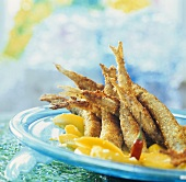 Fish (smelt) in nut crust on fruit