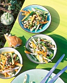 Kohlrabi and carrot salad with tuna on table in open air