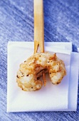 Fried scampo on skewer