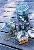 Various pickled herrings in jars