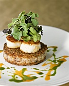Coquilles St. Jacques on risotto burger, garnished with herbs