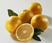 Several grapefruits and half a grapefruit