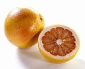 Pink grapefruit and half a grapefruit