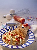 Scrambled egg with sheep's cheese, salami & wholemeal toast