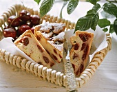 Pieces of cherry quark cake on paper in basket