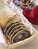 Poppy seed strudel, partly slices, in bread basket