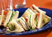 Club sandwiches on cocktail sticks with olives