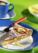 Piece of lemon tart with icing sugar (crostata di limone)