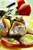 Baked potato with fresh herbs and tomatoes