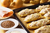 Baked potatoes with ham and sesame
