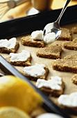 Spreading lemon hearts with beaten egg white