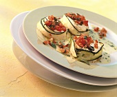 Goat's cheese in courgette strips with tomatoes & vinaigrette