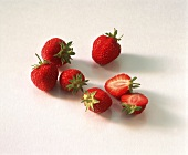 Fresh strawberries, one halved