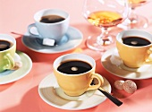 Espresso with sugar lumps, amaretti and cognac