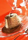 Coffee and hazelnut pudding with chocolate sauce