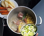 Cooking soup vegetables with bacon