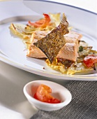 Fried salmon trout with fennel and tomatoes