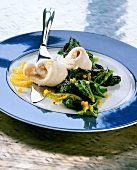 Lemon sole fillets with spinach and diced peppers