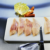 Preparing redfish fillets