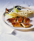 Peking duck with pancakes, sauce and spring onions
