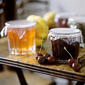 Cherry jam beside jar of quince jam