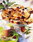 Apricot & cherry cake with slivered almonds on cake plate