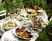 Summer buffet on garden table in open air
