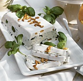 Soft cheese terrine with gorgonzola and pine nuts