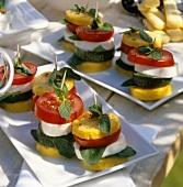 Polenta tower with mozzarella, tomato and courgettes